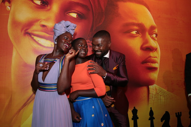 Lupita Nyong'o, Madina Nalwanga and David Oyelowo pose together at the U.S. premiere of DisneyÕs ÒQueen of KatweÓ at the El Capitan Theatre in Hollywood, CA on Tuesday, September 20, 2016.  The film, starring David Oyelowo, Oscar winner Lupita NyongÕo and newcomer Madina Nalwanga, is directed by Mira Nair and opens in U.S. theaters in limited release on September 23, expanding wide September 30, 2016...(Photo: Alex J. Berliner/ABImages)